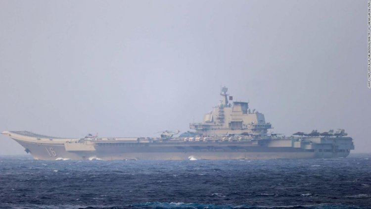 China flanks Taiwan with military exercises in air and sea