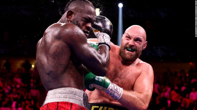 Fury knocks out Wilder to retain WBC title in heavyweight fight for the ages